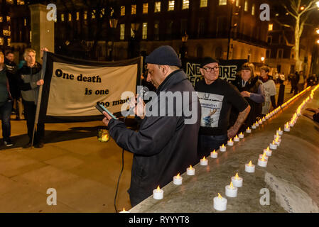 London, UK. 15th March 2019. A vigil by Streets Kitchen DPAC and other groups mourned the many deaths of homeless people on our streets, 799 in the last 18 months. Hundreds die each year because of lack of shelter, at least one person every day, a shameful indictment of the failure of national and local government to provide the care it should for citizens. Government cuts since 2010 have led to a huge increase in the number of homeless on our streets and to deaths. In a country as rich as hours with so many empty buildings no one should be homeless. Credit: Peter Marshall/Alamy Live News - Stock Image