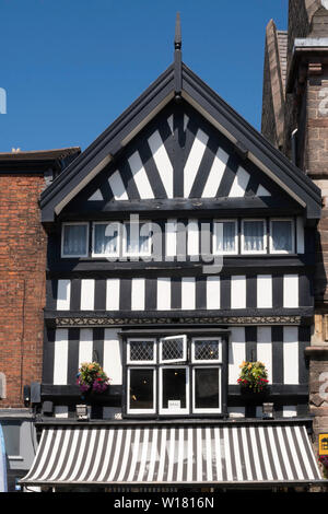 A half timbered building next to Congleton town hall in the High Street, Cheshire, England, UK - Stock Image