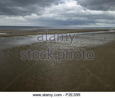 Gloomy vista of empty sea and sand at Omaha Beach, Charlie and Dog Green sector.  On D-Day the Charlie Company of the 2nd Ranger Battalion landed here - Stock Image