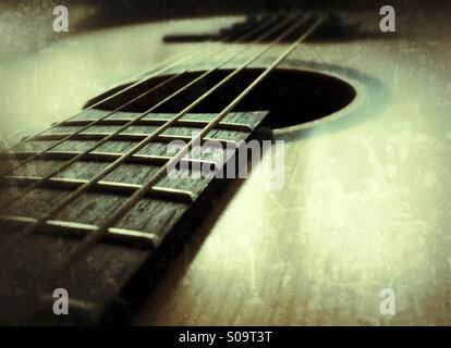Close-up of the steel strings on a classic guitar. - Stock Image