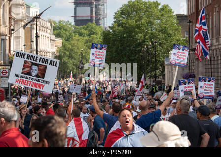 London, United Kingdom. 14 July 2018. A 'Free Tommy' demonstration has been held in Whitehall to protest against the jailing of Stephen Yaxley-Lennon better known by the pseudonym Tommy Robinson. In May 2018 Robinson was sentenced to ten months for contempt of court and a previous three months' suspended sentence was activated. Credit: Peter Manning/Alamy Live News - Stock Image