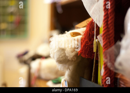 A clutter of multi coloured haberdashery, threads, yarns and wool with room for text - Stock Image
