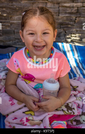 1, one, Hispanic girl, girl drinking from baby bottle, Castro Valley, Alameda County, California, United States, - Stock Image