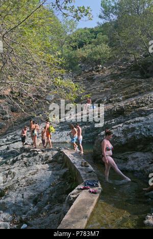 young bathers in Fonia river, Samothraki Island, Greece - Stock Image