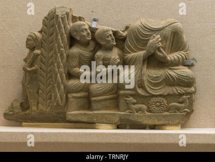 Fragment of a Frieze in Grey Schist,Showing Buddha with Attendants. 2nd-3rd Century. Central Gandhara. Department of Archaeology and Museums, Pakistan - Stock Image