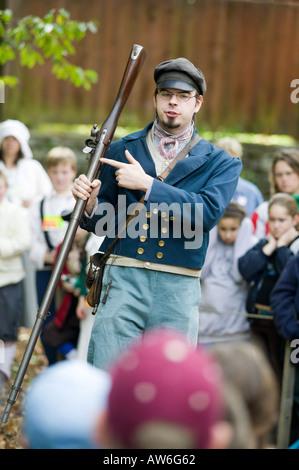 Man Firing Musket Gun Old Sturbridge Village History Museum of New England Sturbridge Massachusetts - Stock Image