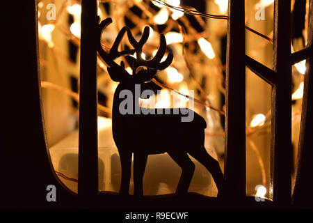 Reindeer Christmas Candle Holder - Stock Image