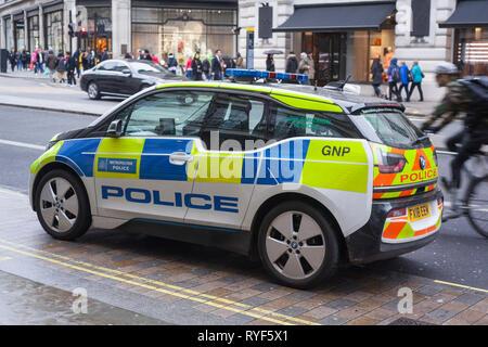 A low emission BMW i3 Metropolitan Police car parked in Regent Street., London. - Stock Image