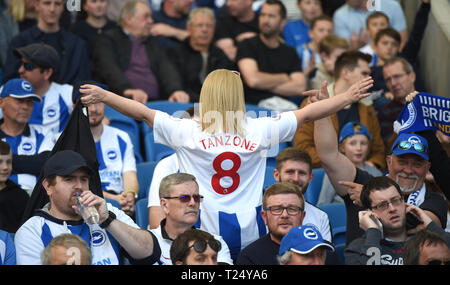 Fans during the Premier League match between Brighton & Hove Albion and Southampton at The American Express Community Stadium . 30 March 2019 Editorial use only. No merchandising. For Football images FA and Premier League restrictions apply inc. no internet/mobile usage without FAPL license - for details contact Football Dataco - Stock Image