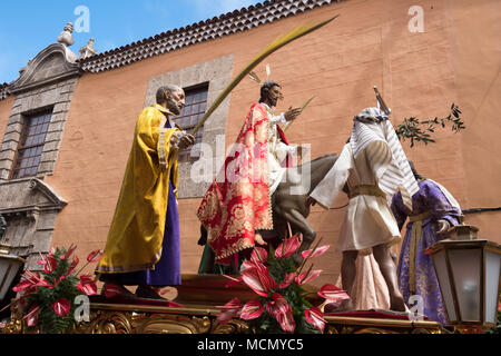Tenerife, Canary Islands, a float of Jesus riding on a donkey is pulled through the streets of La Laguna during the  Palm Sunday Holy Week procession. - Stock Image