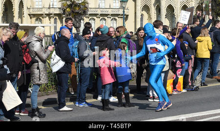 Brighton, Sussex, UK. 14th Apr, 2019. Thousands of runners and spectators take part in this years Brighton Marathon which is celebrating its 10th anniversary Credit: Simon Dack/Alamy Live News - Stock Image
