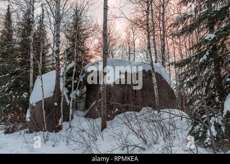 Glacial erratic, giant granite boulders covered under snow. Duluth, Minnesota, USA. - Stock Image