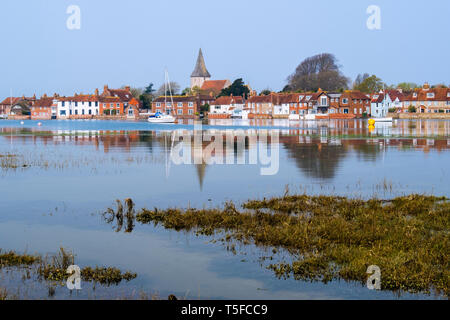 Picturesque old village reflected in still waters of Bosham Creek at high tide in Chichester harbour. Bosham, West Sussex, England, UK, Britain - Stock Image