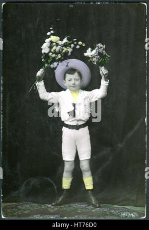 SWITZERLAND - CIRCA 1908: A postcard printed in Switzerland shows a boy with flowers, circa 1908 - Stock Image
