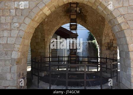old water pump mechanism in israel - Stock Image
