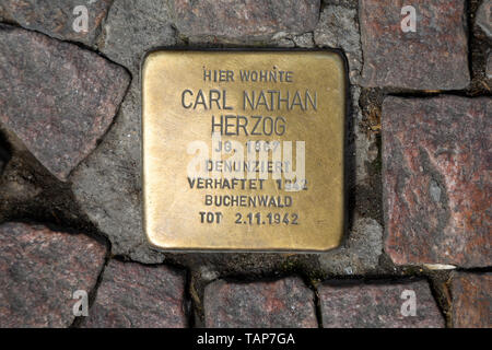 Stolperstein (stumbling stone) in Wiesbaden, the state capital of Hesse, Germany. - Stock Image