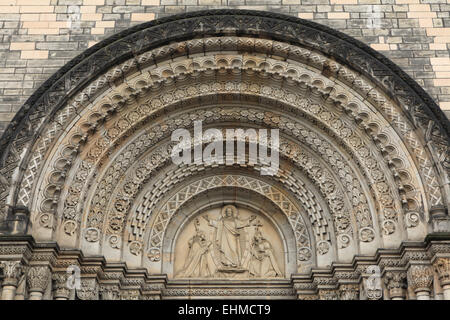 Jesus Christ blesses to St Cyril and Methodius. Romanesque portal of St Cyril and Methodius' Church in Prague, - Stock Image