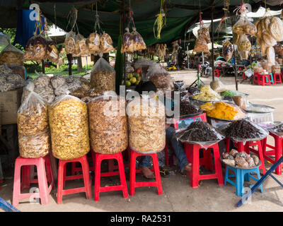 Stall at Skuon Town Market selling dried fruit bananas dates pineapple mango and cashew nuts Cambodia Asia - Stock Image