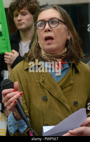 London, UK. 17th October 2018. Beverley, a home owner from Green Quarter Manchester, speaks at the protest outside the Ministry of Housing, Communities and Local Government by residents living in tower blocks covered in Grenfell-style cladding, Fuel Poverty Action, and Grenfell campaigners demanding that the government make all tower-block homes safe and warm. Credit: Peter Marshall/Alamy Live News - Stock Image