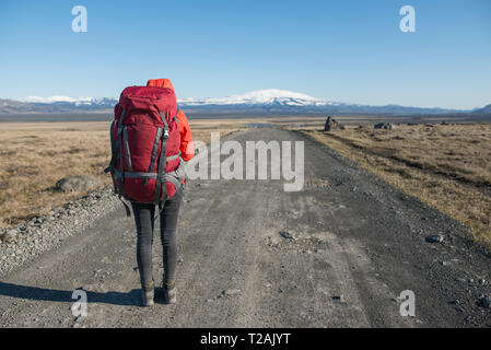 Hiker on road in Fjallabak Nature Reserve in Iceland - Stock Image