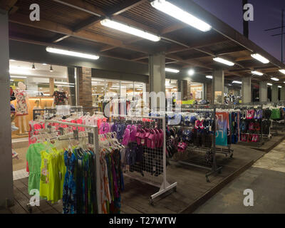 After dark shopping for beachwear along the main street in the holiday resort Ayia Napa Cyprus - Stock Image