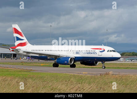 British Airways daily scheduled flight departing from Inverness airport in the Scottish Highlands. - Stock Image