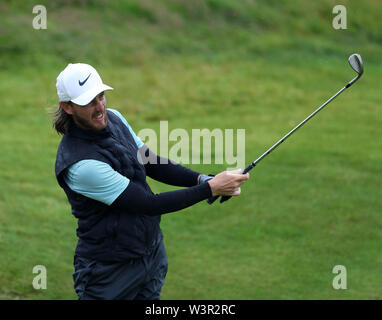 Portrush, County Antrim, Northern Ireland. 17th July 2019. The 148th Open Golf Championship, Royal Portrush Golf Club, Practice day ; Tommy Fleetwood (ENG) plays a pitch shot to the 13th green Credit: Action Plus Sports Images/Alamy Live News - Stock Image