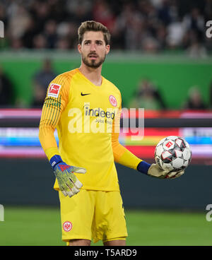 Wolfsburg, Germany. 22nd Apr, 2019. Soccer: Bundesliga, 30th matchday: VfL Wolfsburg - Eintracht Frankfurt in the Volkswagen Arena. Frankfurt goalkeeper Kevin Trapp is in goal. Credit: Peter Steffen/dpa - IMPORTANT NOTE: In accordance with the requirements of the DFL Deutsche Fußball Liga or the DFB Deutscher Fußball-Bund, it is prohibited to use or have used photographs taken in the stadium and/or the match in the form of sequence images and/or video-like photo sequences./dpa/Alamy Live News - Stock Image
