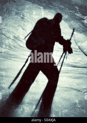 Winter shadow of a ski mountaineer in the snow. - Stock Image