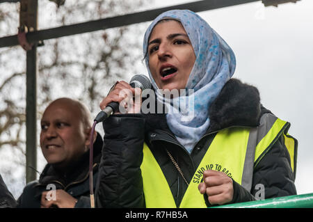 London, UK. 9th Dec, 2018. A Muslim woman speaks at the rally by united anti-fascists in opposition to Tommy Robinson's fascist pro-Brexit march. The protest by both remain and leave supporting anti-fascists gathered at the BBC and marched to a rally at Downing St. Police had issued conditions on both events designed to keep the two groups well apart. Credit: Peter Marshall/Alamy Live News - Stock Image