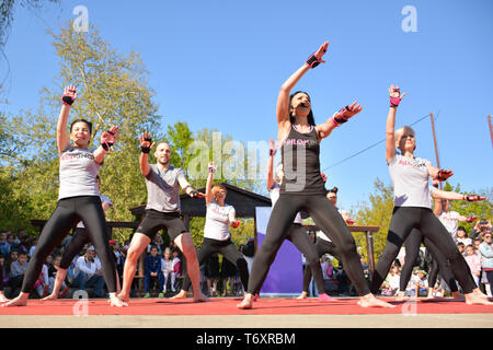 Nis, Serbia - April 20, 2019 People gathered to perform Piloxing training during the day, outdoor sport activities on sunny spring day - Stock Image