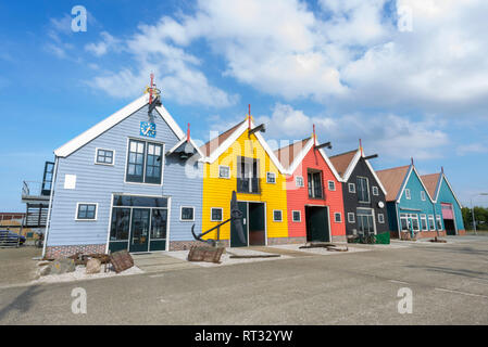 Beautiful colourful (ware)houses in fishing village Zoutkamp, Groningen, The Netherlands. - Stock Image