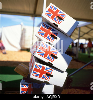 Union Jack flag label on unstable precariously stacked supermarket fresh food packing boxes about to topple Great Britain UK KATHY DEWITT - Stock Image