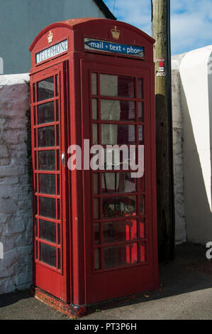 An archetypical British phone box upgraded to offer email as well as telephone connections, Hartland, Devon, England - Stock Image