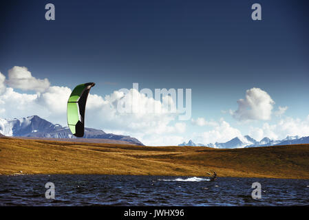Kite surfing at mountain lake - Stock Image