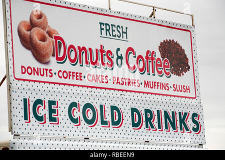 Fresh Donuts and Coffee sign at Highland Games - Stock Image