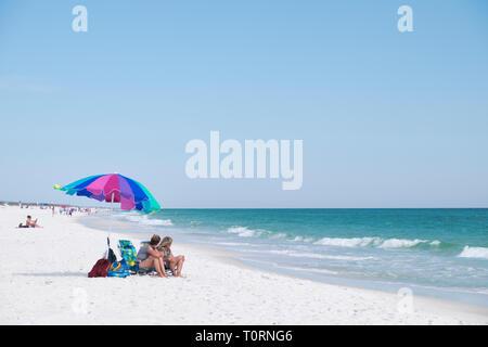 Tourists on vacation at Santa Rosa Island, Florida, USA - Stock Image