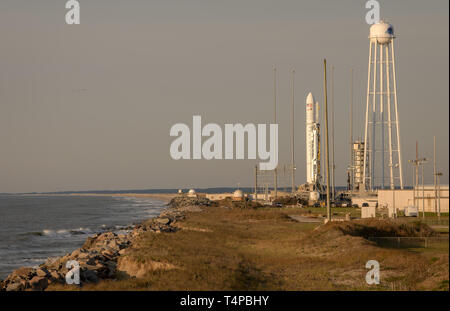 The Northrop Grumman Antares rocket, with Cygnus resupply spacecraft onboard, sits on launch Pad-0A at the NASA Wallops Flight Facility April 17, 2019  in Wallops, Virginia. The rocket is schedule to deliver 7,600 pounds of science and research, crew supplies and vehicle hardware to the International Space Station later in the day. - Stock Image