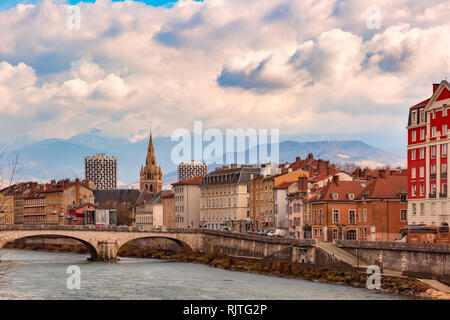 Church, Isere river and bridge in Grenoble, France - Stock Image