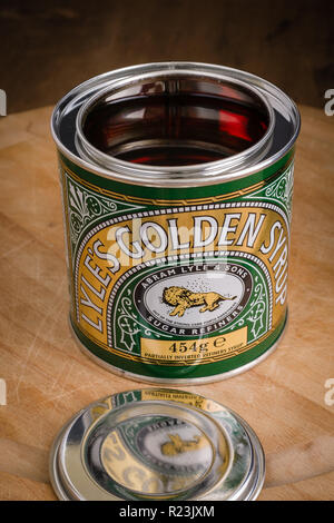 Lyles Golden Syrup invented by Abram Lyle with its distinctive green and gold metal tin marketed since 1885 the worlds oldest unchanged packaging - Stock Image
