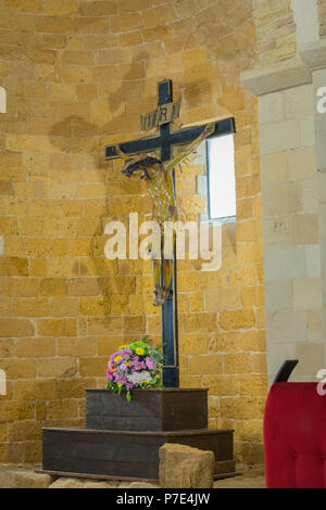 Italy Sicily Agrigento old town Cathedral Duomo Cattedrale Museo Diocesano Church religion Christian Catholic Crucifix Cross bunch flowers - Stock Image
