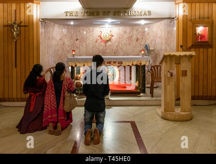 Horizontal view of people praying at the tomb of St. Thomas in Chennai, India. - Stock Image