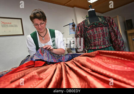 Dirndl designer Christine Thieme works on a traditional  Steingadener dress in her tailoring in Lechbruck, Germany, - Stock Image