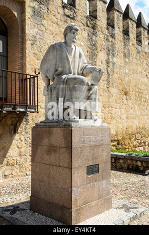 The statue of the medieval Andalusian scholar Averroes sits outside the City Walls in Cordoba, Andalucia, Spain. - Stock Image