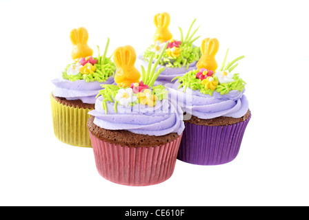 Easter cupcakes decorated with chocolate bunnies and sugar decorations - Stock Image