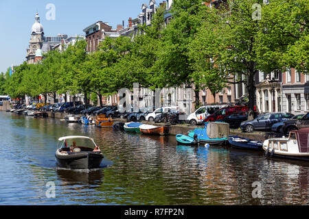 Boats on the Keizersgracht canal Amsterdam, Netherlands - Stock Image