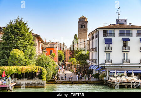 SIRMIONE, LAKE GARDA, ITALY - SEPTEMBER 2018: Lakeside buildings and the Hotel Flaminia lakeside at Sirmione on Lake Garda - Stock Image