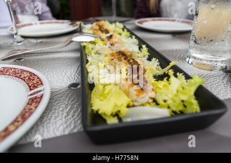 Fish starter plate at an Italian restaurant in Liguria. - Stock Image