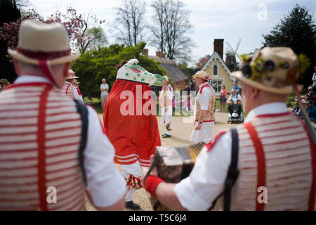 Thaxted Essex England UK 22 April 2019. Traditional Easter Bank Holiday Monday Morris Dancing in Thaxted Church Yard. Thaxted Morris in red and white  - Stock Image