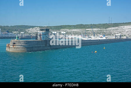 Dover harbour and sea wall see from Car Ferry outside the harbour - Stock Image